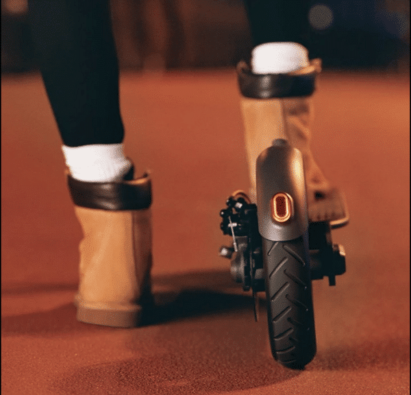 Hush e-scooter with rider feet